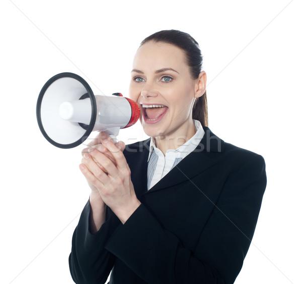 Joli dame directives mégaphone blanche affaires Photo stock © stockyimages