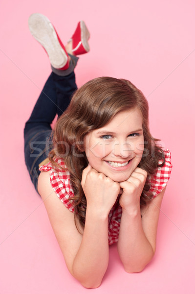 Beautiful girl posing with hands on chin Stock photo © stockyimages