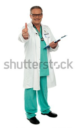 Medical practitioner showing excellent gesture Stock photo © stockyimages