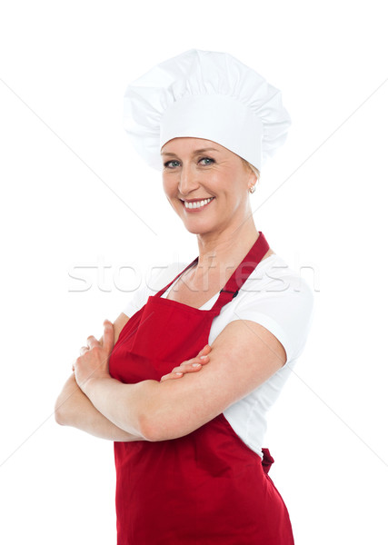 Happy middle aged woman with crossed hands Stock photo © stockyimages