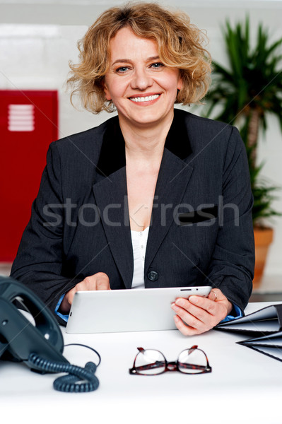 Corporate lady operating wireless tablet device Stock photo © stockyimages