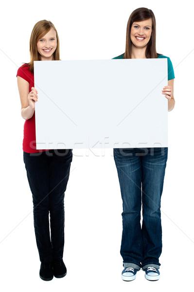 Paire bonne recherche femmes Photo stock © stockyimages