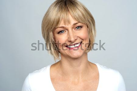 Snap shot of a cheerful sexy blonde Stock photo © stockyimages