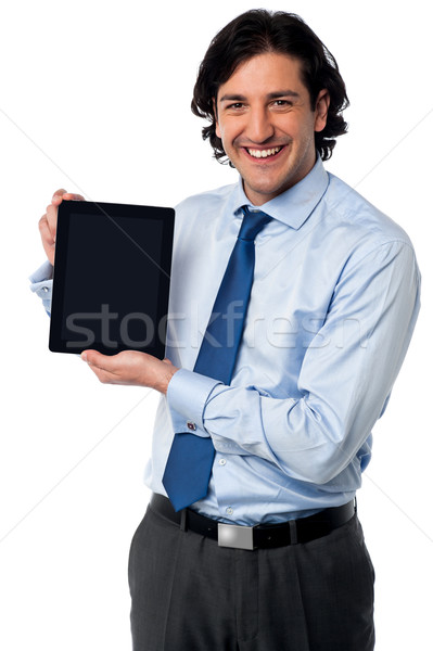 Sales manager displaying newly launched tablet pc Stock photo © stockyimages