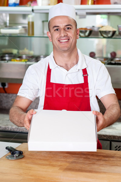 Here is the pizza you ordered! Stock photo © stockyimages
