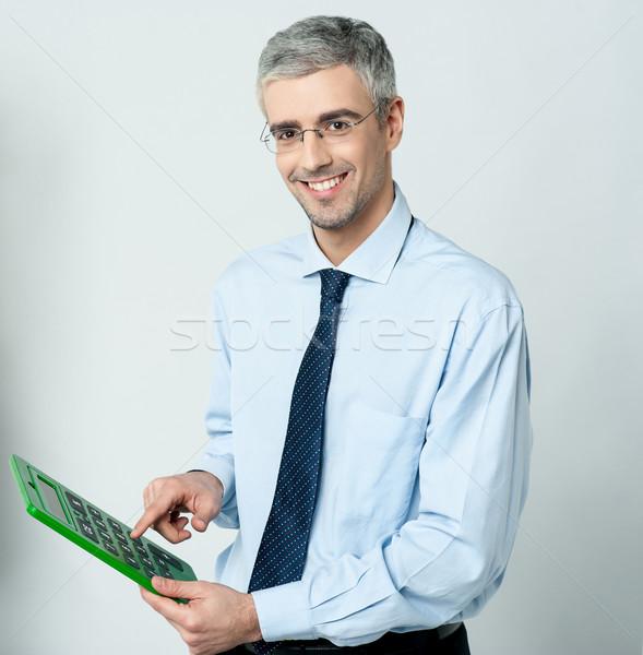 ストックフォト: 企業 · 男 · 電卓 · 笑みを浮かべて · 作業 · ビッグ
