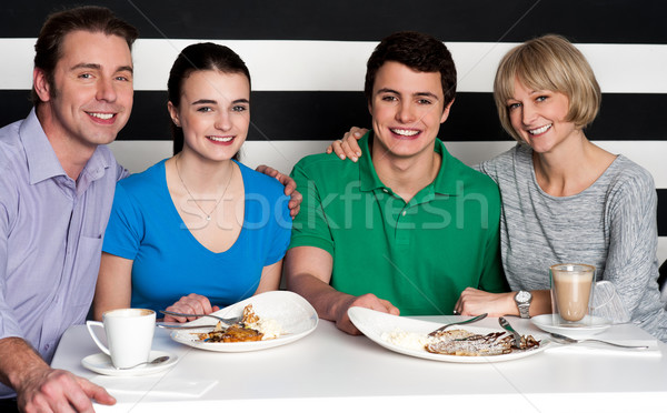 Family enjoying dinner at a restaurant Stock photo © stockyimages