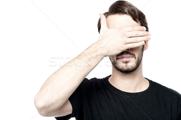 Man making see no evil gesture Stock photo © stockyimages