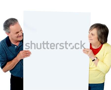 Ouderdom paar presenteren banner samen witte Stockfoto © stockyimages