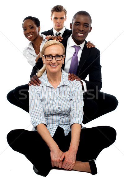 Equipo de negocios tiempo trabajo posando línea Foto stock © stockyimages