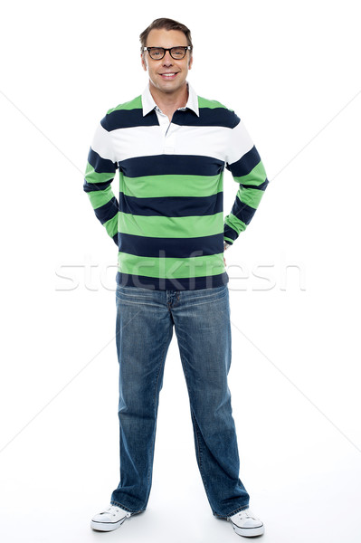 Full length shot of handsome casual male model Stock photo © stockyimages
