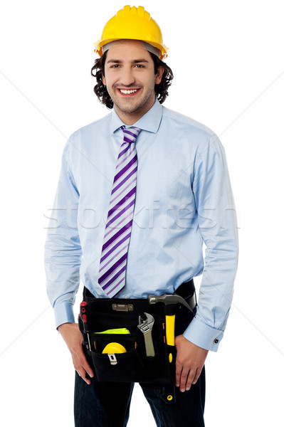 Smiling male architect wearing tool belt Stock photo © stockyimages