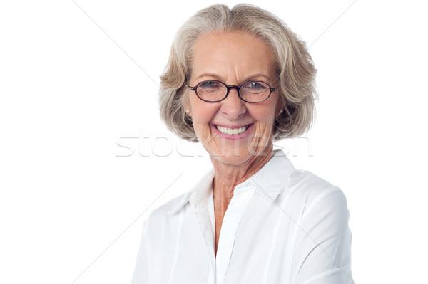 Gelukkig senior vrouw pose portret Stockfoto © stockyimages