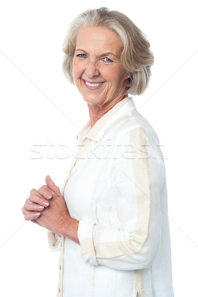 Portrait of smiling attractive old woman Stock photo © stockyimages