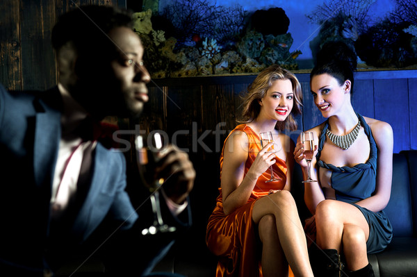 Pretty girls staring at handsome young man Stock photo © stockyimages