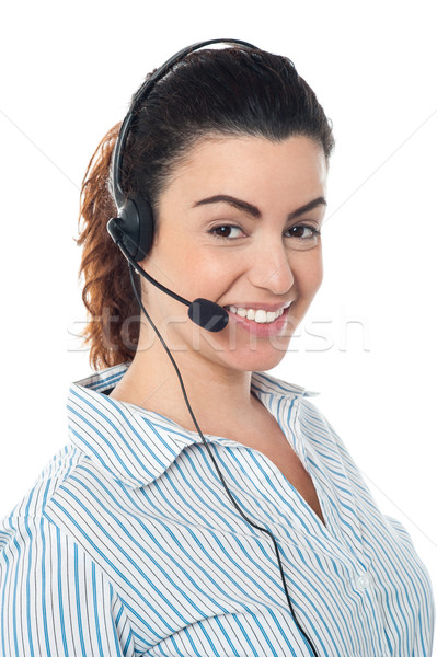Young call center woman with headset Stock photo © stockyimages