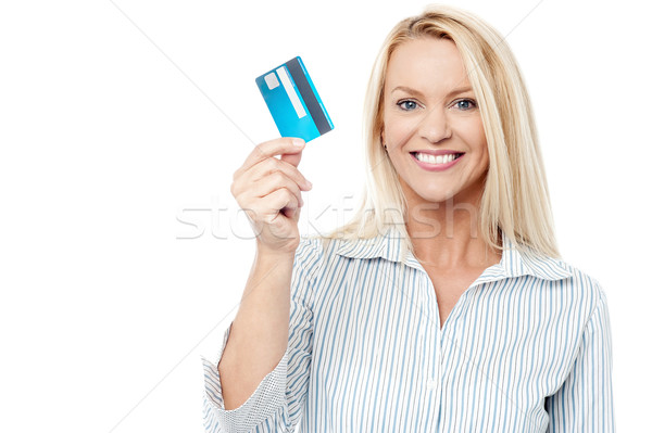 Smiling female model holding up credit card. Stock photo © stockyimages