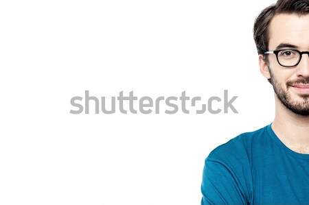 Cropped image of a smiling young man Stock photo © stockyimages