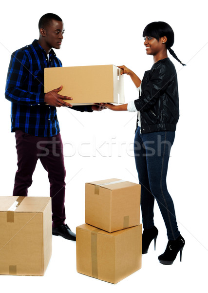 Couple moving empty cartons Stock photo © stockyimages