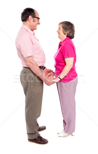 Man and woman holding each others hand Stock photo © stockyimages
