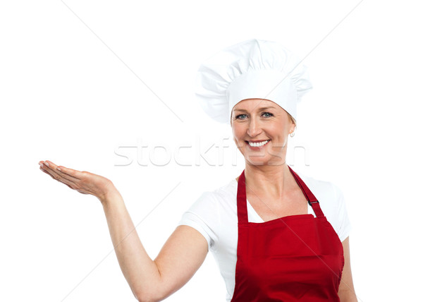 Smiling senior cook showing copy space Stock photo © stockyimages