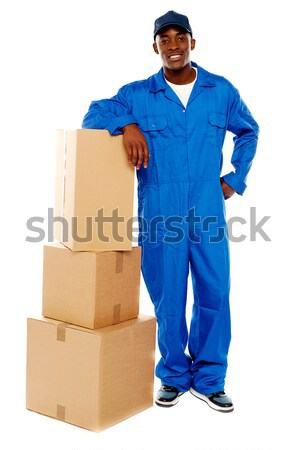 Relocation staff member resting against stack of cartons Stock photo © stockyimages