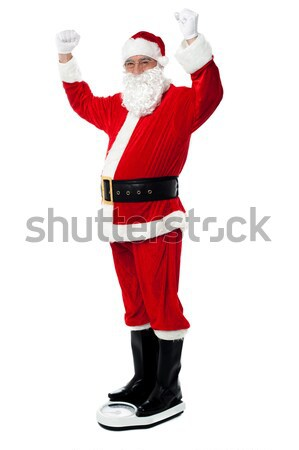 Santa sheds precious pounds! Stock photo © stockyimages