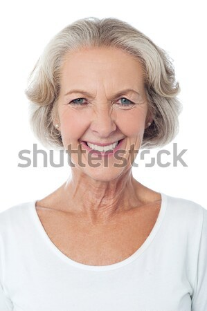 Snap shot of a smiling blonde looking upwards Stock photo © stockyimages