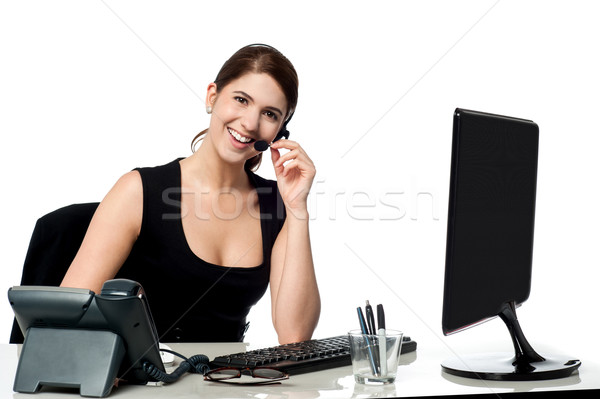Female executive assisting client over a call Stock photo © stockyimages
