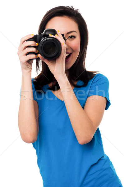 Young girl taking photos Stock photo © stockyimages