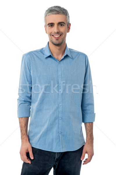 Relaxed young man posing casually Stock photo © stockyimages