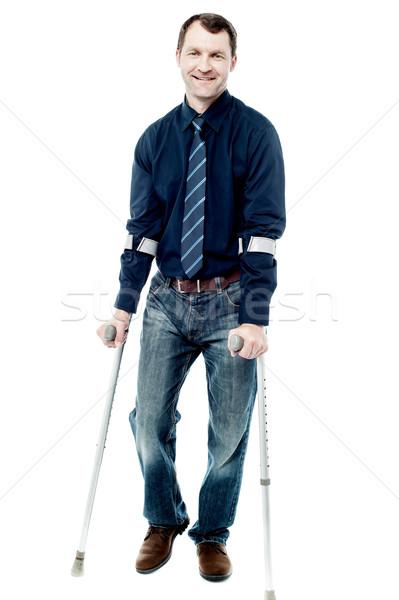 Człowiek spaceru kule kalekiego odizolowany biały przystojny Zdjęcia stock © stockyimages