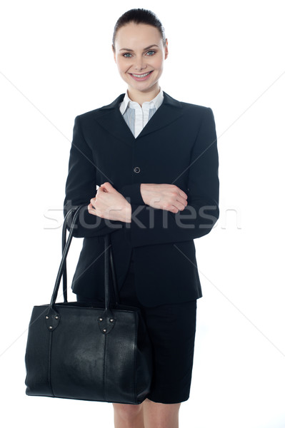 Coporate lady holding a handbag Stock photo © stockyimages