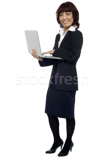 Lets get back to work. Woman with laptop Stock photo © stockyimages