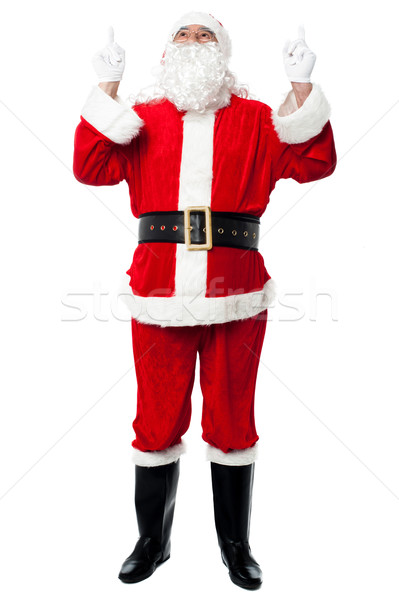 Saint Nicholas looking and pointing upwards Stock photo © stockyimages