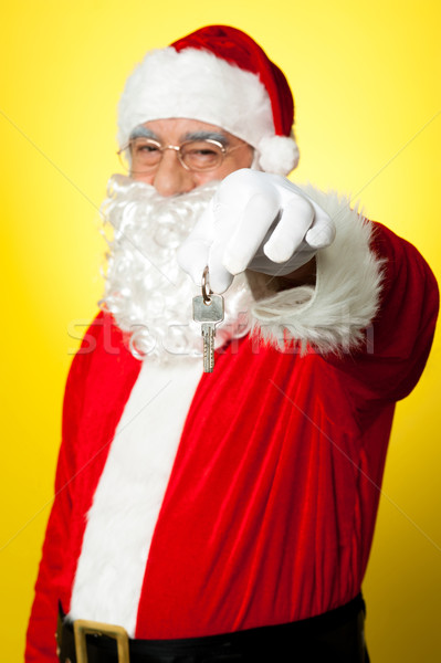 Aged Santa dangling a key Stock photo © stockyimages