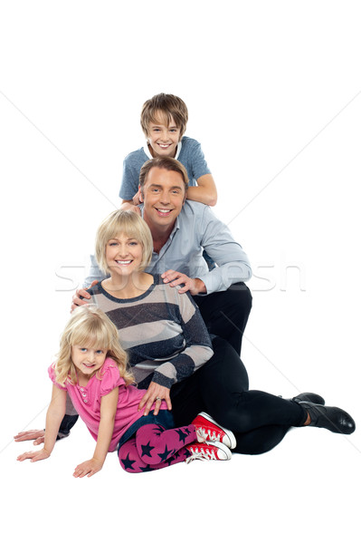 Closely bonded family in a studio Stock photo © stockyimages
