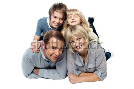 Adorable young kids piled on top of their parents Stock photo © stockyimages