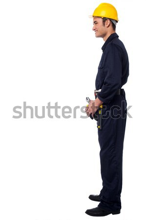 Side pose of smiling young construction worker Stock photo © stockyimages
