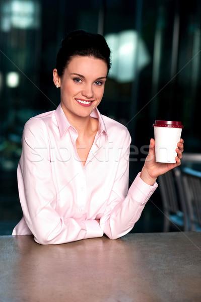 Pretty lady enjoying chilled liquid refreshment Stock photo © stockyimages