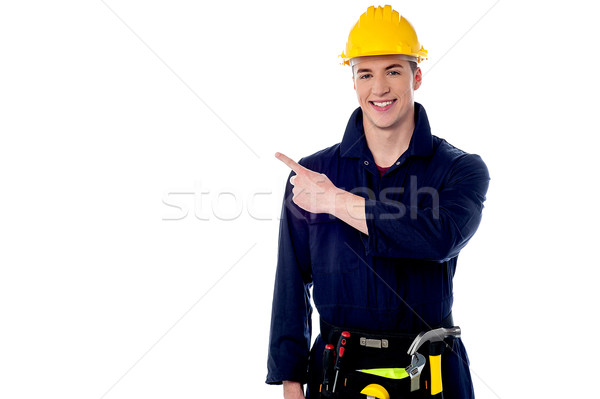 Construction worker pointing away Stock photo © stockyimages
