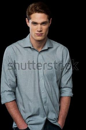 Young man causal posing Stock photo © stockyimages
