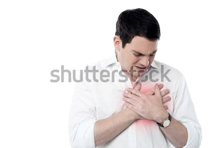 Young man having heart attack Stock photo © stockyimages