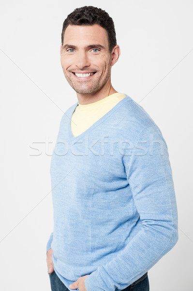 Handsome man posing casually Stock photo © stockyimages