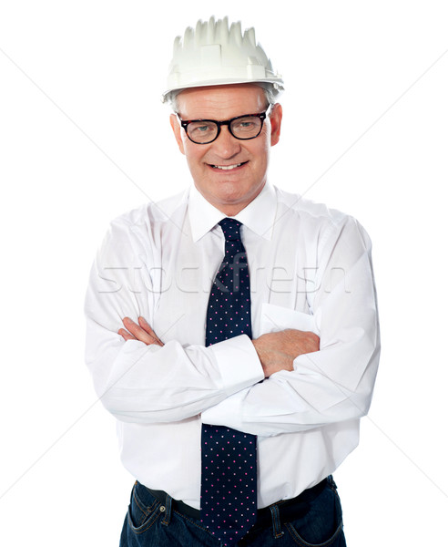 Portrait of happy senior foreman with hard hat Stock photo © stockyimages
