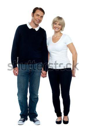 W średnim wieku para stwarzające strony silne klejenie Zdjęcia stock © stockyimages