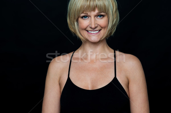 Glamorous woman in sleeveless black spaghetti top Stock photo © stockyimages
