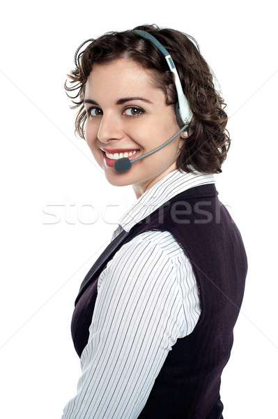 Gorgeous executive turning back and looking at you Stock photo © stockyimages