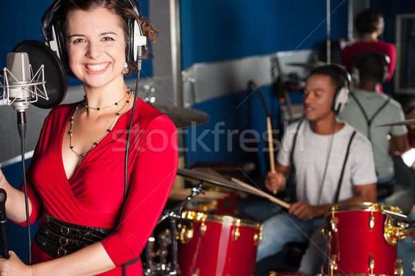 Female singer recording a track in studio Stock photo © stockyimages