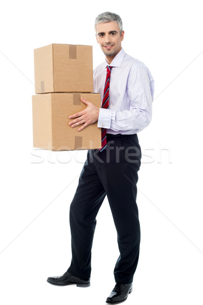 Stock photo: Corporate man holding stack of parcel boxes